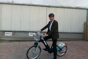 Alastair Dalton tries out one of the brand new Just Eat Cycles electric bikes. Picture: The Scotsman