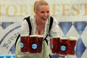 Traditional German dress and beer by arm-load is in order at Oktoberfest. Picture: Edinburgh Oktoberfest.