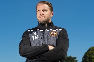 Robbie Neilson has guided his team to the top of the Ladbrokes Championship but he isn't getting carried away. Picture: Ross MacDonald/SNS