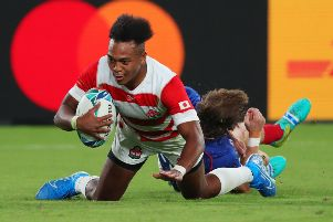 Japan's Kotaro Matsushima scores his team's fourth try in their victory against Russia. Picture: Mike Hewitt/Getty Images