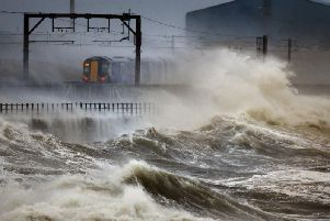 The Climate Change Adaptation Programme sets out 170 policies and actions to be taken by Holyrood to mitigate the harm caused by storms, flooding and coastal erosion. Picture: PA