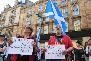 Pro-independence campaigners protest against the selection of Boris Johnson as Prime Minister outside the Glasgow Royal Concert Hall. Picture: John Devlin