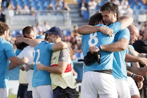 Uruguay's players celebrate a famous win over Fiji