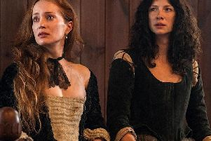 The fictional Geillis Duncan (left) appeared in the dock accused of witchcraft in Outlander. Picture: Outlander/Starz