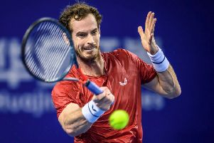 Andy Murray of Britain hits a return against Alex de Minaur of Australia during their men's singles second round match at the Zhuhai Championships tennis tournament in Zhuhai in China's southern Guangdong province on September 26, 2019. (Photo by STR / AFP) / China OUTSTR/AFP/Getty Images