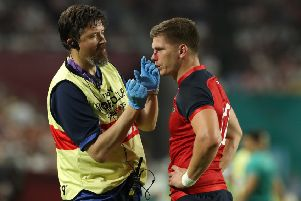 Owen Farrell receives attention following the tackle that led to USA's John Quill being dismissed.  Picture: Getty