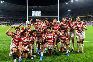 Japan's players celebrate victory over Ireland. Picture: William West/AFP/Getty Images