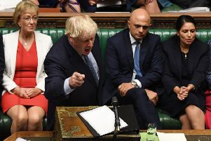 Prime Minister Boris Johnson (C) gesturing while answering questions on the proroguing of Parliament. Pic: Getty Images