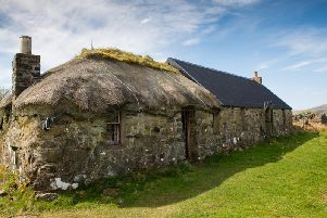 Sheila's Cottage on Ulva is being restored and rethatched using traditional materials from the island. PIC: Contributed.
