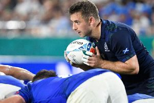 Greig Laidlaw preapres to feed a scrum during the Pool A match