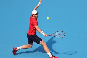 Andy Murray battled well against Matteo Berrettini to reach the second round