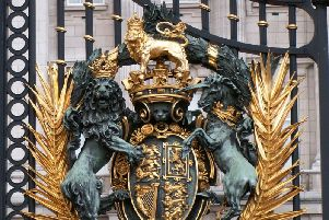 The gates at Buckingham Palace are decorated with elaborate Royal Coat of Arms fixtures. Picture: CC BY-SA 3.0