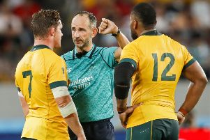 Australia centre Samu Kerevi, right, was controversially penalised against Wales. Picture: Odd Andersen/AFP/Getty Images