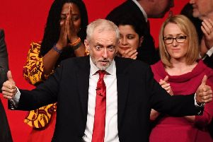 Jeremy Corbyn acknowledges the cheers of Labour party members. Photograph: Leon Neal/Getty
