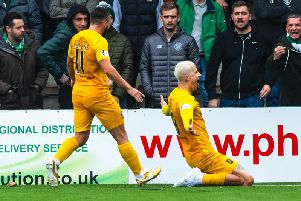Lyndon Dykes celebrates having put his side 2-0 up. Picture: SNS