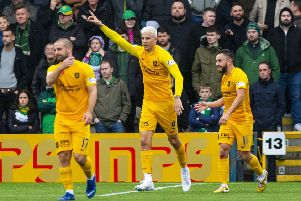 Lyndon Dykes, celebrating his goal against Celtic, is qualified to play for Scotland. Picture: SNS
