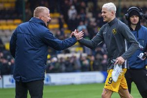 Livingston manager Gary Holt congratulates Lyndon Dykes as he leaves the field on Sunday. Picture: SNS.