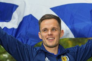 Lawrence Shankland flies the flag at a Scotland media session at the Oriam ahead of the Euro 2020 qualifying double-header. Picture: Bill Murray/SNS