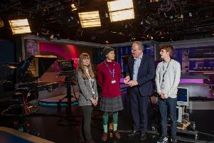 Some of the students with MD of broadcasting at STV, Bobby Hain, in the news studios. Picture: Contributed