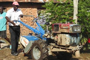 Howard Msukwa, chair of the rice farmers' association, trying out a new rotavator, supplied by Paisley-based fair-trade company JTS (Picture: JTS).