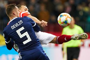 Scotland defender Mikey Devlin tries to get to grips with Russia striker Artem Dzyuba in Moscow. Picture: Oleg Nikishin/Getty