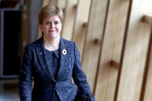 First Minister Nicola Sturgeon arrives ahead of First Minister's Questions at the Scottish Parliament in Edinburgh. Picture: Jane Barlow/PA Wire