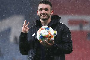 John McGinn poses with the match ball following his first-half hat-trick in Scotland's 6-0 rout of San Marino. Picture: Ian MacNicol/Getty Images