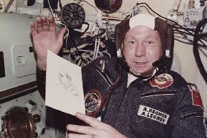 Alexei Leonov holds up his drawing of opposite number Thomas P Stafford to the camera on the Apollo-Soyuz mission. Picture: Space Frontiers/Getty