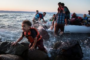 Think Odysseus was cruel? Today many are indifferent to the struggles of desperate people on the wine-dark sea, like this group of Syrian refugees arriving on the island of Lesbos after traveling in an inflatable raft from Turkey. (Picture:: UNHCR/Andrew McConnell)