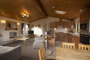 A main living space with kitchen, dining and lounge areas, and two separate bedrooms and a bathroom make the lodges at Parkdean Resorts Tummel Valley site a good option for family holidays
