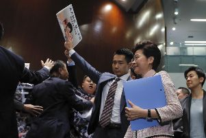 Hong Kong Chief Executive Carrie Lam, center right, arrives at chamber of the Legislative Council in Hong Kong. (AP Photo/Kin Cheung)