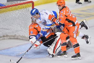 Paul Crowder collides with Sheffield Steelers netminder Tomas Duba. Pic: Dean Woolley