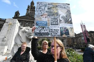 A mother holds a placard at the event. Drug death gathering  held in Glasgow City Centre for International Overdose Awareness Day. Picture: John Devlin