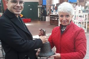 The bell from the MV Kyles, which is believed to be the oldest Clyde-built vessel still afloat in the UK, is held by Scottish Maritime Museum curator Matthew Bellhouse Moran (left) and Carole Harries (right), who donated it to the museum after finding it in her garage in Glamorganshire in South Wales.