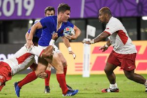 Antoine Dupont in action for France against Tonga