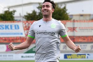 Stevie Mallan celebrates his first-half strike, but Hibs' wait for a second league win goes on