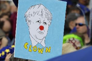 A placard depicting Boris Johnson at yesterday's demonstration for a People's Vote in London. Picture: 'Kirsty Wigglesworth/AP