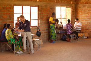 Dr Gavin McColl working in a clinic in Zambia.