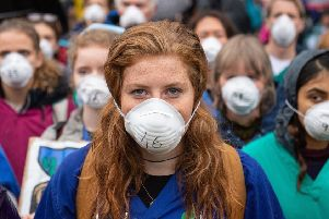 Doctors protest in support of Extinction Rebellion in London to highlight deaths caused by air pollution. (Picture: Dominic Lipinski/PA Wire)