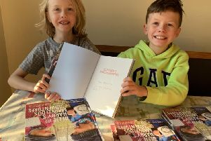 Brothers Ollie (right), 10, and Harry Ferguson (left), seven, are working their way through a bucket list of 500 adventures.