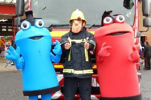 A Lincolnshire County Council photo of their three mascots, including Fireman Sam (centre)
