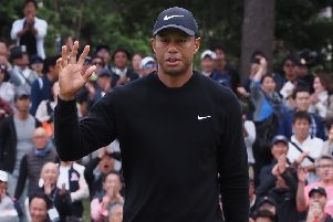 Tiger Woods acknowledges the fans on the 5th green in the first round of the Zozo Championship. Picture: Toshifumi Kitamura/AFP/Getty