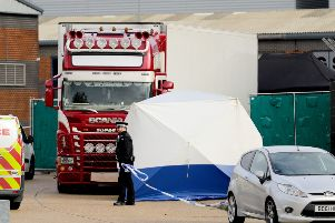 The lorry in which the bodies were found behind police tape at the Waterglade Industrial Park in Grays, Essex. Picture: Aaron Chown/PA