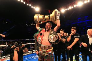 Josh Taylor with the Muhammad Ali Trophy and IBF and WBA belts. Picture: Getty Images