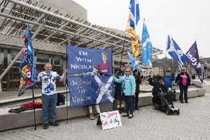 Are people flocking to join pro-independence campaigners like these outside Holyrood parliament? (Picture: Andrew O'Brien)