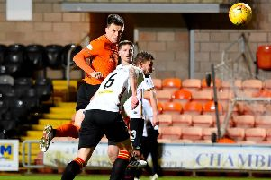 Lawrence Shankland heads home Dundee United's winner in the 62nd minute.