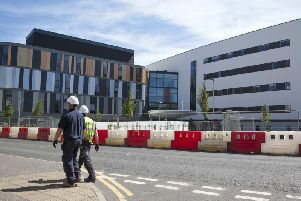 The new hospital should have opened in July but has now been delayed until autumn next year.