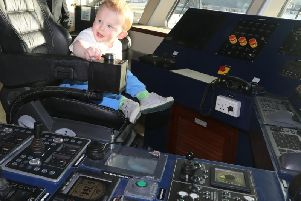 MV Alfred owner Andrew Banks' grandson Eddy, one, in the captain's chair of the brand new vessel. Picture: Orkney Photographic
