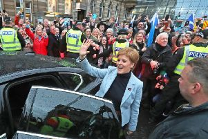 Nicola Sturgeon arrives at George Square for a mass pro-independence rally. Picture: PA