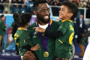 South Africa captain Siya Kolisi celebrates victory in the Rugby World Cup final with his two children. Picture: Getty